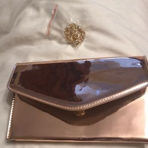NWOT rose gold patent style Steve Madden Clutch